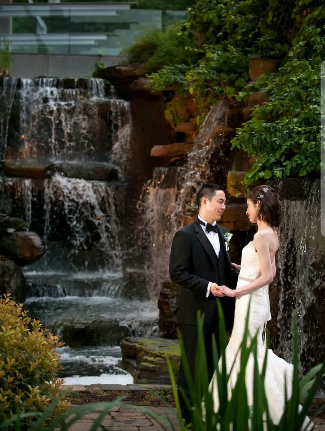 Pictured: couple getting married in front of the waterfalls